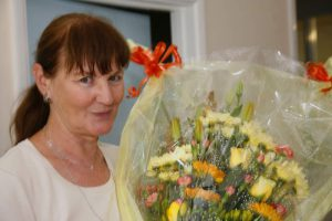 Prism's Brenda Butcher was presented with flowers, a cake and her long service watch to mark her 25 years service with the company.