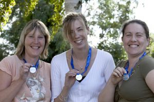 Pictured with their race medals are Lindsay Webb (centre) flanked by Nicola Shepherd (left) and Kellie Whitworth (right).