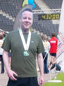 Prism account manager Glen Dear ran this year's Milton Keynes Marathon to raise money for Cancer Research.